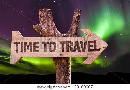 Time to Travel direction sign with aurora borealis background
