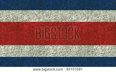 Costa Rica flag texture on green grass in the garden for background
