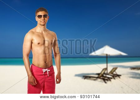 Man on beach at Maldives, South Male Atoll. Collage.