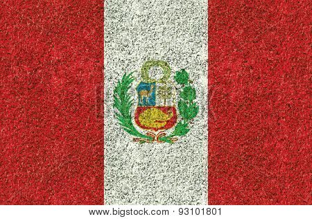 Peru flag texture on green grass in the garden for background