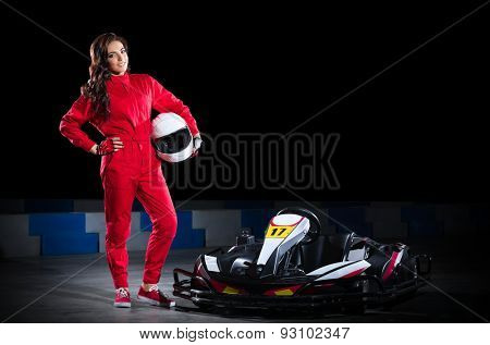 Young girl karting driver isolated