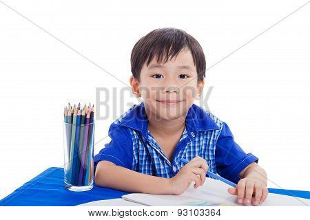 Boy Smiling And Drawing