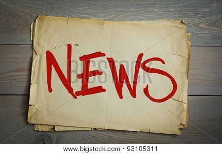 News. Old paper on a wooden background