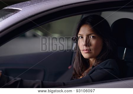 Young Woman Driving Her Car At Night