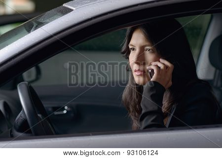 Woman Driver Sitting Chatting On Her Mobile