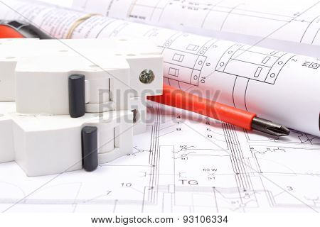 Rolled Electrical Diagrams, Electric Fuse And Work Tools On Construction Drawing Of House
