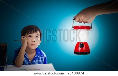 Asian Boy Thinking And Looking Up, Hand Holding Plastic Electric Lantern