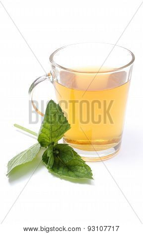 Fresh Green Mint And Cup Of Beverage In Background