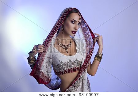 Beautiful Indian Woman In Traditional Sari Clothing With Bridal Makeup And Oriental Jewelry