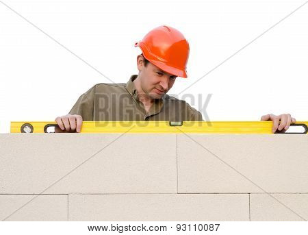 Builder Checks A Level Of A Brick Wall