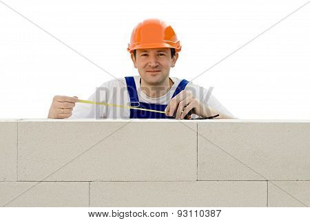 Worker Builds A Wall