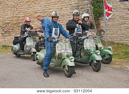 bikers at the time control of classic Vespa rally