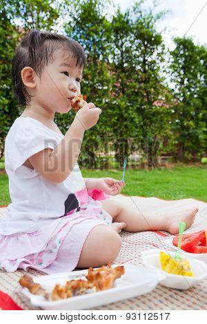 Little Asian (thai) Girl Enjoy Eating Her Lunch