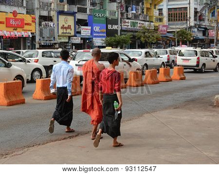 Burmese People Walk On The Street In Yangon