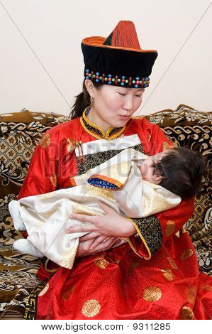 Mongolian Woman And Baby