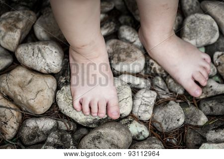 Child's Foot Learns To Walk On Pebbles, Reflexology Massage