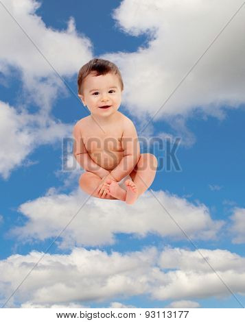 Funny baby in diaper sitting on a cloud on the sky