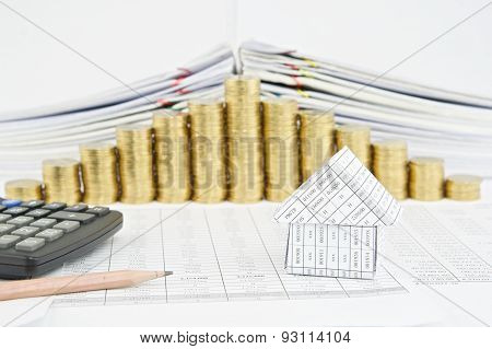 Pencil And House With Step Pile Of Gold Coins