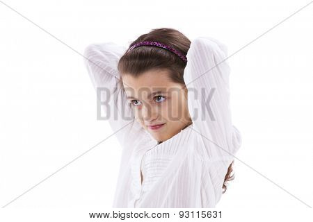 Little girl with her hands on her hair