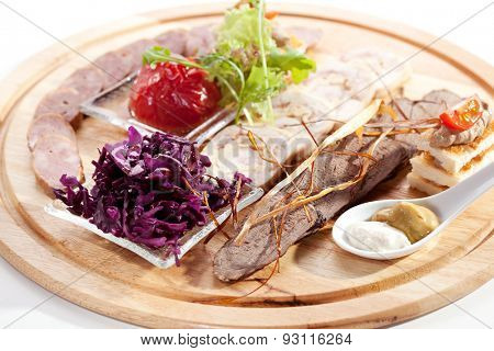 Various Meat Delicacies with Marinated Vegetables