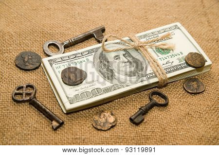 One Pack Of Dollars, Coins And Keys On An Old Cloth
