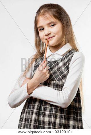 Thoughtful Schoolgirl Chewing Pencil Against White Background