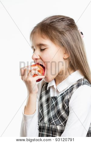 Isolated Portrait Of Cute Schoolgirl Biting Red Apple