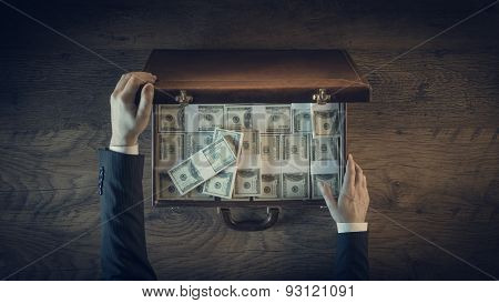 Rich Vintage Businessman With Lots Of Dollar Packs