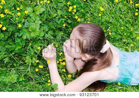 The Child The Girl Lies On A Glade With Flowers