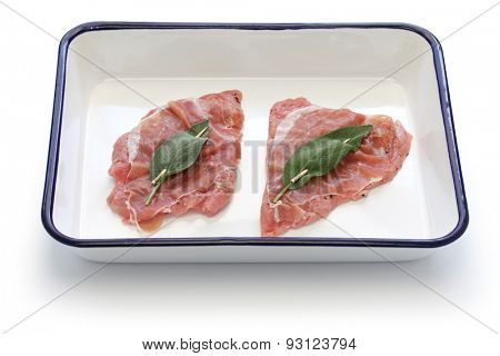 saltimbocca ingredients ( veal, prosciutto and sage) on butcher tray