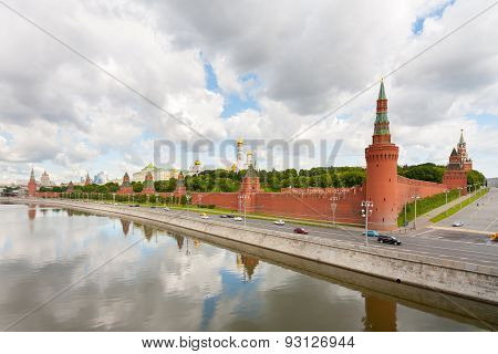 Moscow Kremlin On Moskva River Coast On Background Of Cloudy Sky