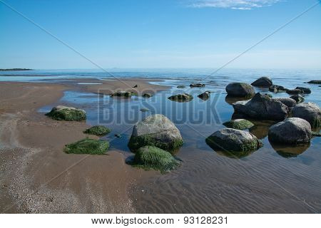 Sandy beach landscape with small rocks