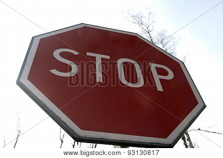 Stop Sign Against The Sky.