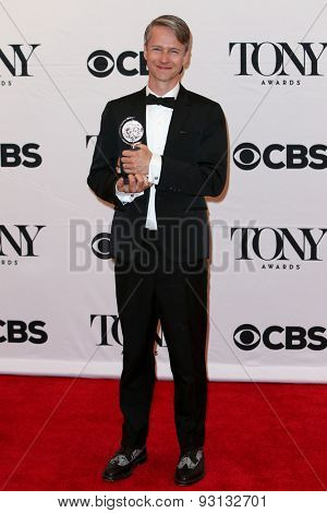 NEW YORK-JUN 7: Actor John Cameron Mitchell holds the trophy at the American Theatre Wing's 69th Annual Tony Awards at Radio City Music Hall on June 7, 2015 in New York City.