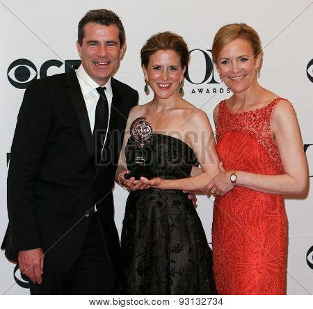 NEW YORK-JUN 7: (L-R) Michael Isaacson, Barbara Whitman and Kristen Caskey hold trophy at the American Theatre Wing's 69th Annual Tony Awards at Radio City Music Hall on June 7, 2015 in New York City.
