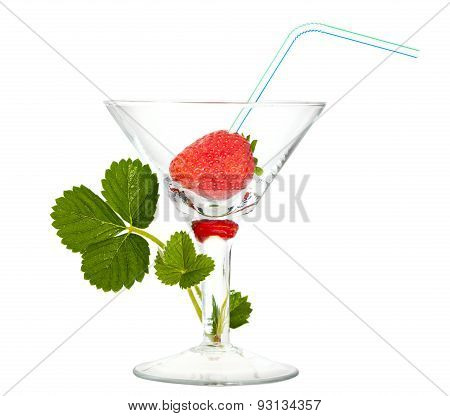 Juicy Strawberry With Cocktail Straw In Glass And Green Sprout Isolated Over White