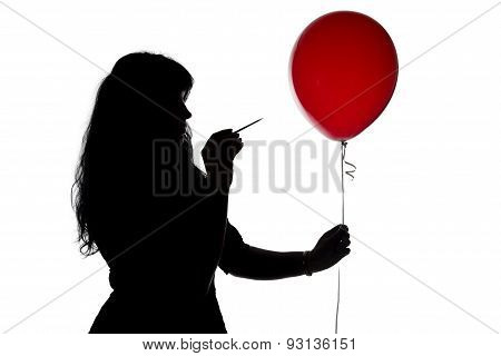 Photo pierced woman with a needle balloon