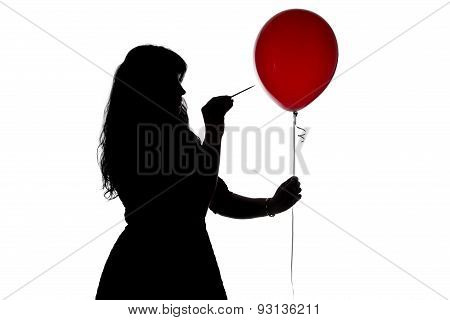 Woman's silhouette pierced with a needle balloon