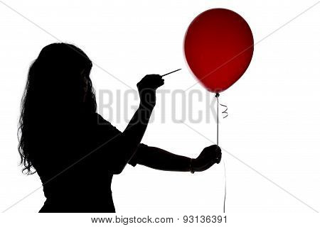 Silhouette of woman pierced with a needle balloon