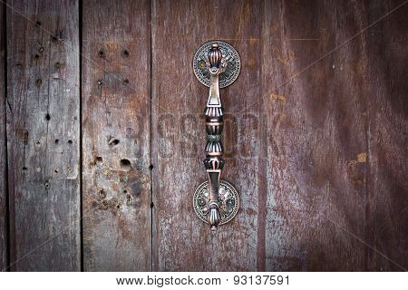 Door Handle On Wood Background