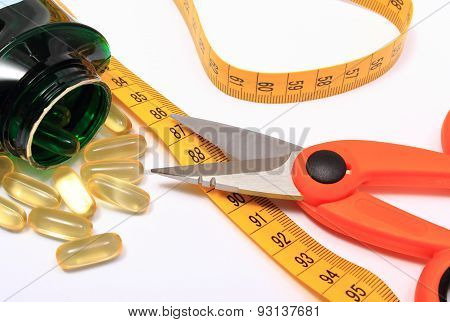 Scissors With Tape Measure And Medical Pills On White