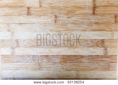 Board of bamboo. Wooden surface with scratches.