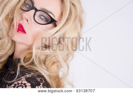 Portrait Of The Beautiful Sensual Woman With Long Blond Hair With Green Eyes In The Ubiquitous Makeu