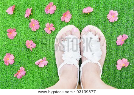 Woman Feet With Flowers