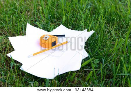 Drawings with pencil and roulette on green grass