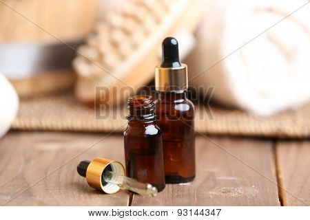 Beautiful spa composition with aroma oil on table close up