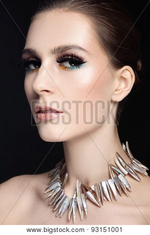 Portrait of young beautiful slim woman with stylish make-up and false eyelashes