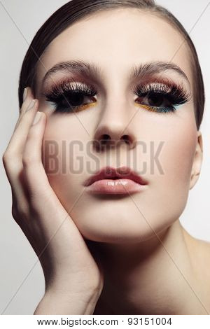Close-up portrait of young beautiful woman with stylish make-up and fancy false eyelashes, selective focus