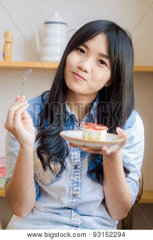 Beautiful Smiling Young Woman Biting Strawberry Cake In Bakery Shop