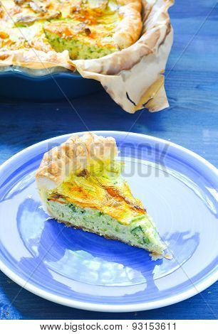 Savory pie with ricotta parmesan and zucchini flowers
